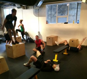 I train harder in groups. That's me in the red struggling to get up. And loving it.
